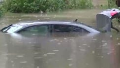 A car is submerged by flooding in Texas.