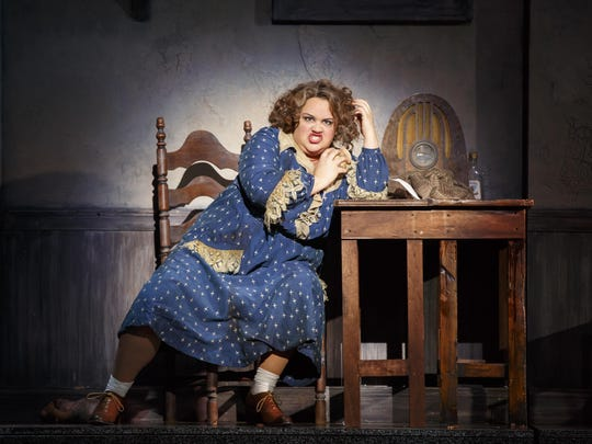 "Lynn Andrews stars as Miss Hannigan in the national touring production of the musical ""Annie."""