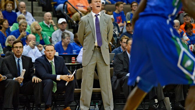 Florida Gulf Coast head coach Joe Dooley yells instructions to his team during the first half of an NCAA college basketball game against Florida, Friday Nov. 11, 2016, in Jacksonville.