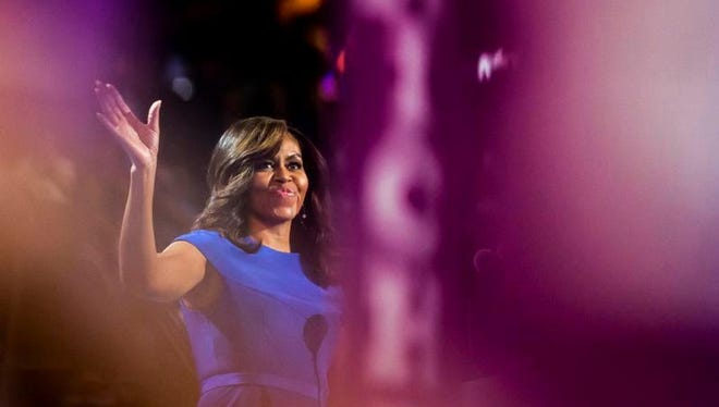 First lady Michelle Obama takes the stage during the Democratic National Convention at Wells Fargo Arena.