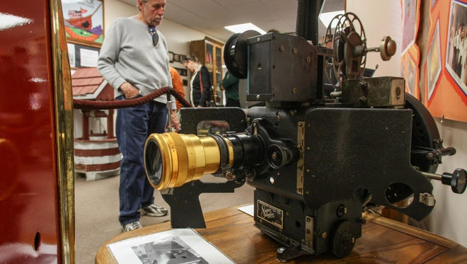 A 2014 visitor to the Bradley Beach Historical Museum checks out a projector head with Cinemascope Lens used at the Beach Cinema from 1998 to 2014.
