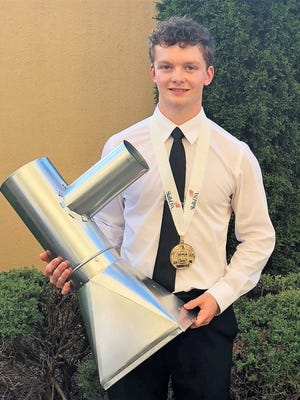 Jared Van Haren, who graduated last month from Oconto Falls High School, holds the sheet metal project he made during the SkillsUSA Championships, held June 27-28 in Louisville, Kentucky. Van Haren won the sheet metal division and was awarded the gold medal.