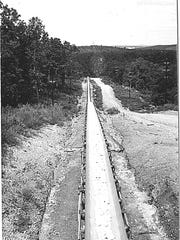 The conveyor belt carrying rock stretched from the quarry near Flippin to the Bull Shoals Dam construction site.