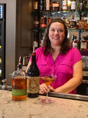 Kate Willer pours up a Manhattan at Bubba in Des Moines. Willer grew up in Des Moines and moved back to Iowa from New York City to manage the Southern restaurant.