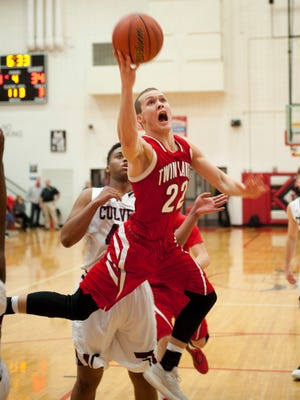 Twin Lakes senior Bryce Bennington drives to the basket in the semifinal victory over Culver Academy.