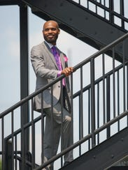 Cleveland Lynch wears J. Ferrar's suit from JCPenney;
