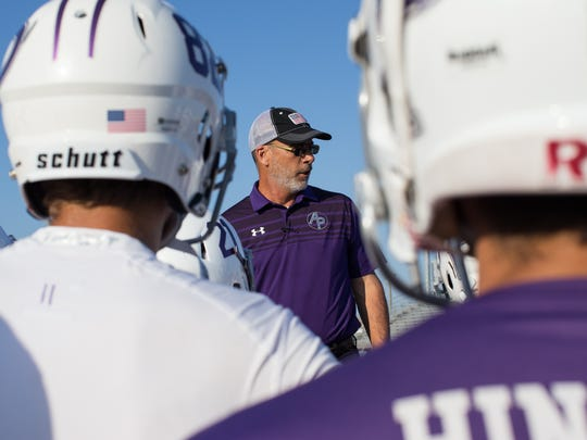 Aransas Pass coach Guy Grover talks to the payers before they warm up for their game against Taft at Akins Wildcat Stadium in Portland on Friday, Sept. 15, 2017.