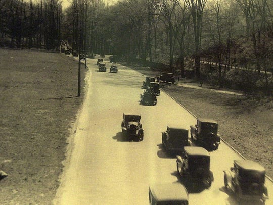 Cars driving in the 1930s.