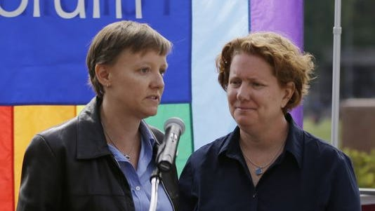 This Sept. 26, 2013 file photo shows plaintiffs Isabelle Barker, left, and her spouse Cara Palladino in Philadelphia. Palladino and Barker have sued Pennsylvania officials to force the state to recognize their 2005 marriage in Massachusetts.