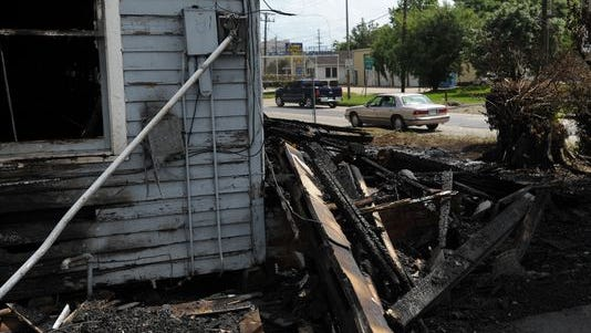 The remains of a home following a fire are seen in the 500 block of NW Evangeline Thruway.