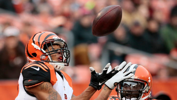 Cincinnati Bengals wide receiver Marvin Jones (82) makes a 21-yard touchdown reception over Cleveland Browns cornerback Charles Gaines (43) in the third quarter during the game at the Cleveland Browns. The Bengals improved to 10-2 with a 37-3 win over the Browns.