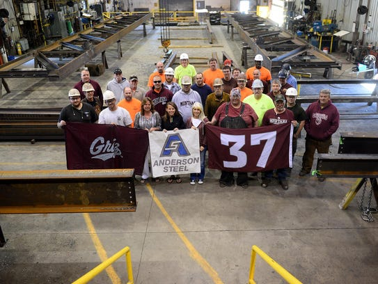 Anderson Steel employees sport their Griz gear. The