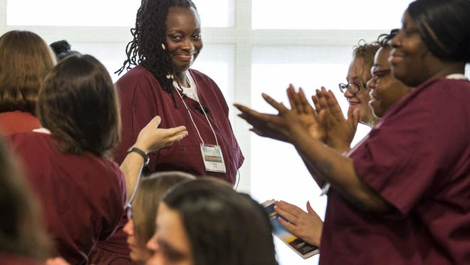Latoya McDuffie receives a standing ovation from her fellow inmates after speaking at the TEDx Wilmington Salon event held at the Baylor Women's Correctional Institution on Friday morning.