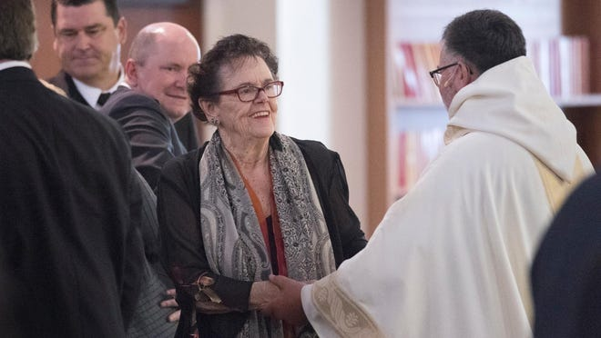 Father Rod Craig, right, greets Carmelita Conn and family members at St. Mary's Catholic Church during a Mass of Christian Burial for her husband retired Superior Court Judge Kenneth Conn on Friday, October 28, 2016. Conn died last Sunday.