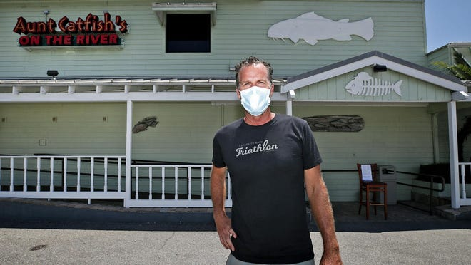 Aunt Catfish's owner Brendan Galbreath stands in front of his Port Orange restaurant on Monday, June 22, 2020. The eatery is set to reopen 3:30 p.m. on Tuesday ending a week-long voluntary closure after an employee tested positive for the coronavirus.