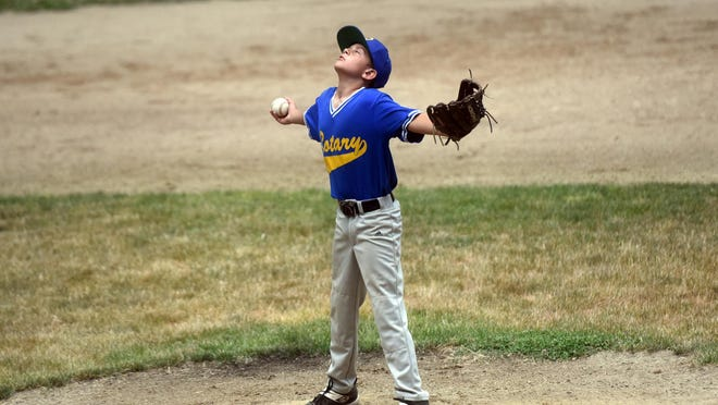 Rotary pitcher Nikolas Uhlir Jr. takes a quiet moment to himself between throws during a Little League game against Insurcomm Wednesday night.