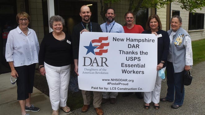 The New Hampshire Daughters of the American Revolution presented a banner to thank the postal service employees at the Heritage Avenue post office in Portsmouth on Thursday. From left, former Postmaster of Portsmouth Pat Hersey, Joanne Coleman Yeaton DAR Ranger chapter, Donald Hildreth and Michael Powers John Taddeo of Northern New England USPS, Barbara Pamboukes DAR Ranger chapter 1st Chapter vice regent, and Shealach Gray DAR Ranger chapter.