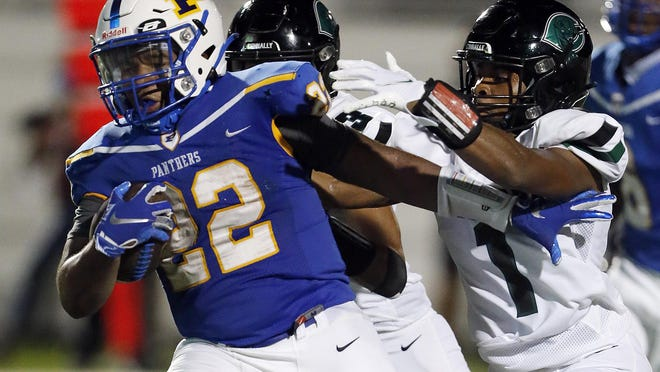 Pflugerville running back Elijah Oakmon runs with the football against the Connally Cougars during Pflugerville's 35-0 win at The Pfield in Pflugerville on Friday. Oakmon had 132 yards rushing and scored two touchdowns in the win.