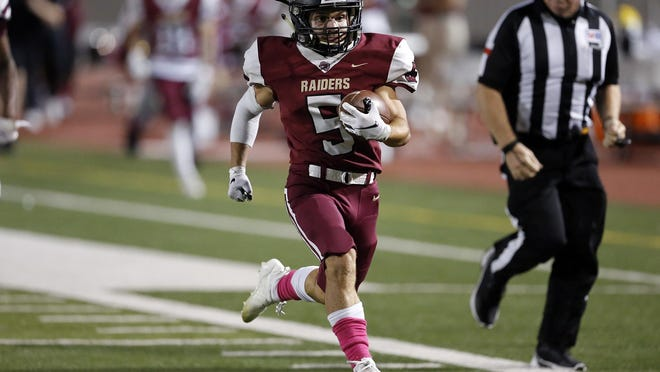 Rouse's Drew Henson outpaces Bastrop defenders for a touchdown during the Raiders' 50-17 win over the Bears at A.C. Bible Jr. Memorial Stadium in Leander on Thursday.