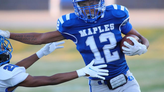 Adrian's Jaylen Hatcher runs the ball during Friday's game against Ypsilanti Lincoln.