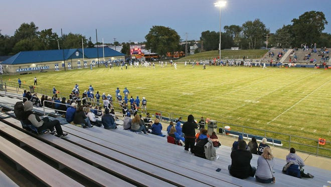 The limited spectators allowed into the contest watch the Adrian High School football team take on Ypsilanti Lincoln during the first week of the season on Sept. 18.
