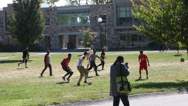 Students play soccer on a Westchester Community College lawn Oct. 8. The college had the region's greatest number of lawsuits for tuition debts in 2014.