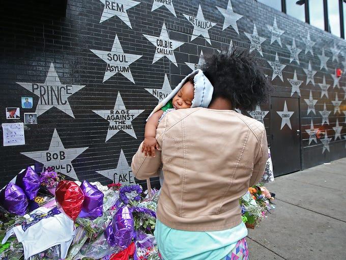 Shanika Haynes, looks at the Prince star and memorials