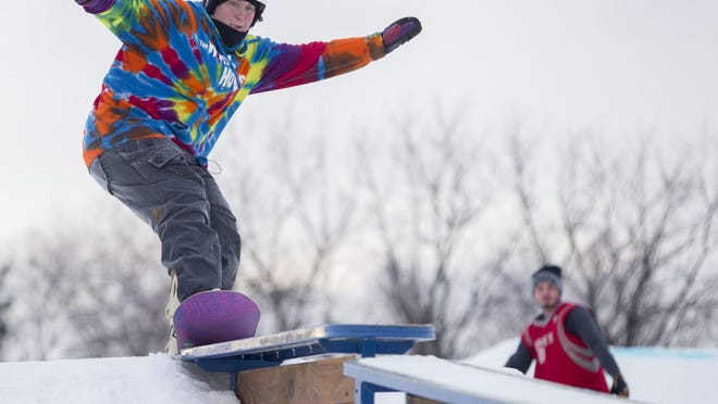 Annie Forrest of Roscoe approaches for a board slide on Jan. 21, 2015, at the grand opening of Gateway Parks at Alpine Hills Adventure Park, now known as Snow Park at Alpine Hills, in Rockford.
