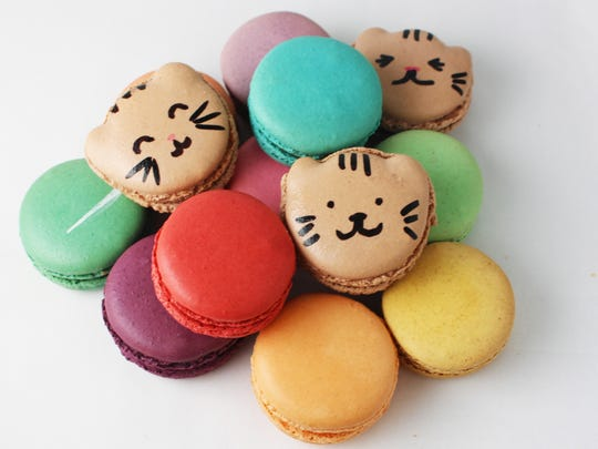 """Catified macarons"" are among the treats for sale at Meow Parlour's patisserie."