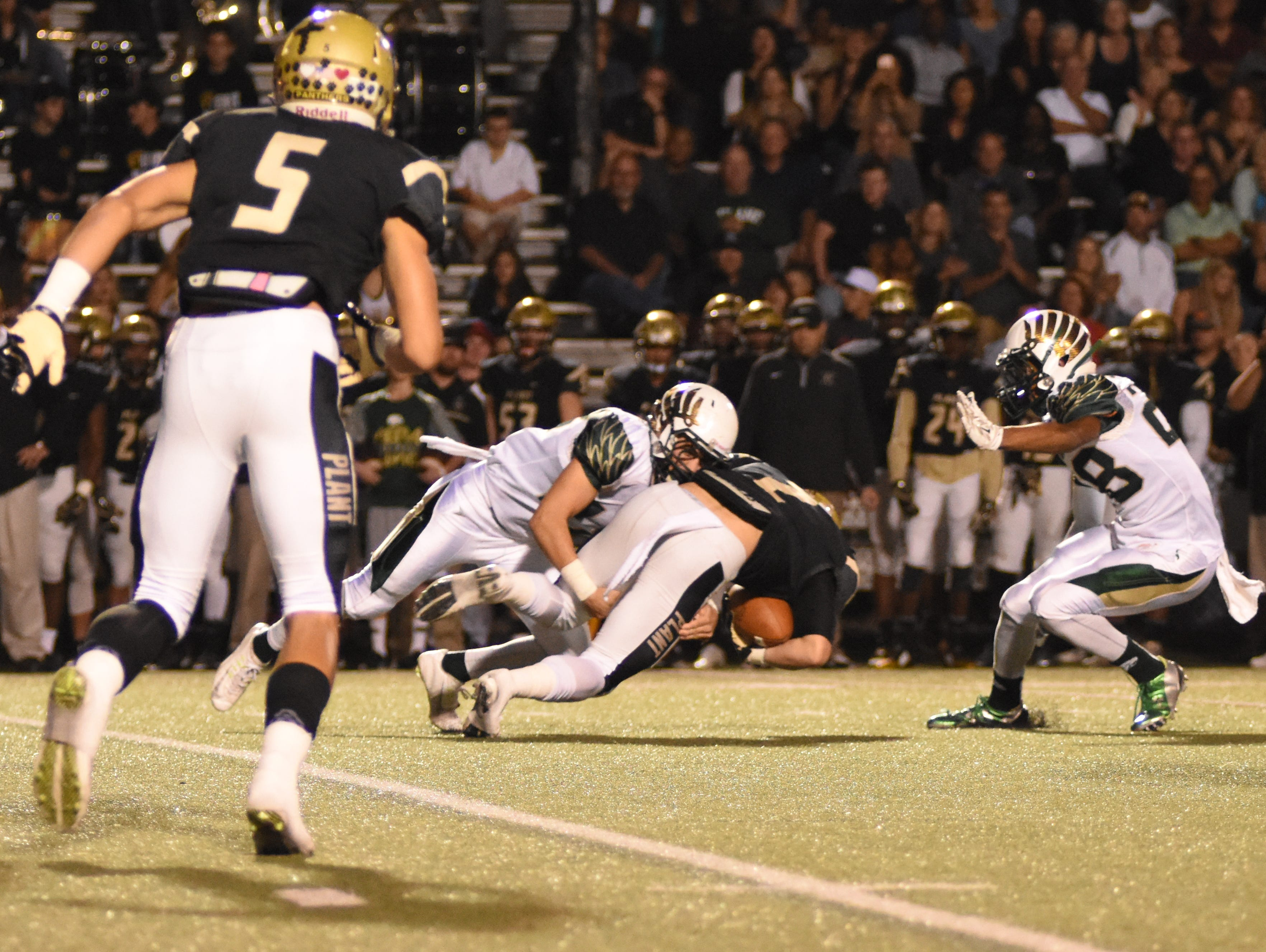 Plant's Christian Watson (7) is brought down by Viera's Brandon Mays (34).