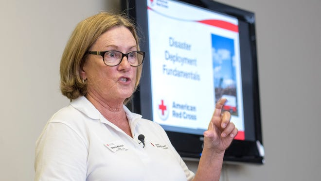 Sheila Mitchell conducts a training session for shelter volunteers at the Northwest Chapter of the American Red Cross in Pensacola on Thursday, September 7, 2017.