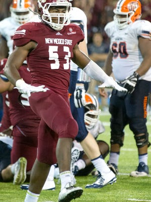 Linebacker Rodney Butler and the New Mexico State defense will try to slow New Mexico's triple option in Saturday's rivalry game in Albuquerque.