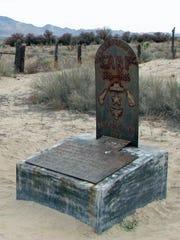 Warren Earp's grave is marked by a steel headstone
