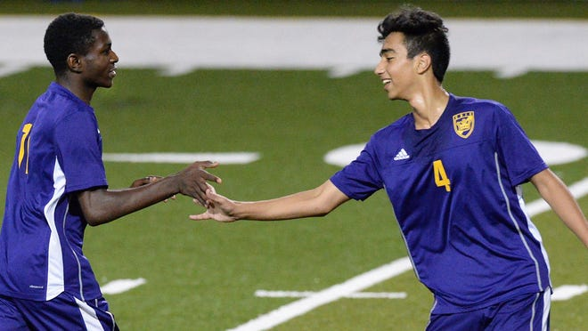 Erie High School senior Abdi Ahmed, left, is congratulated by sophomore teammate Ahmed Saadoon after scoring a goal against Fort LeBouef at Erie Veterans Memorial Stadium in Erie on Sept. 26, 2016.