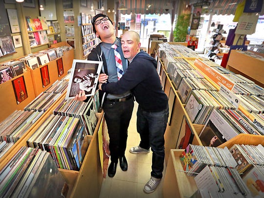 "Luna Music owner Todd Robinson (right) gives Star staff writer Wei-Huan Chen a big hug. The SoBro shop, located at 5202 N. College Ave., is one of Wei's favorite places to hangout during his ""Perfect Weekend."""