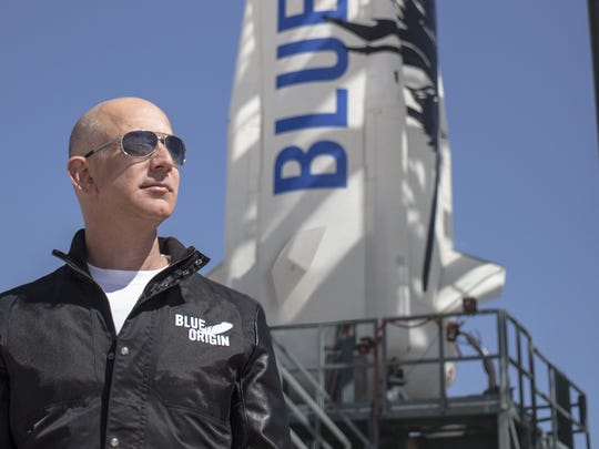 Blue Origin founder Jeff Bezos standing in front of