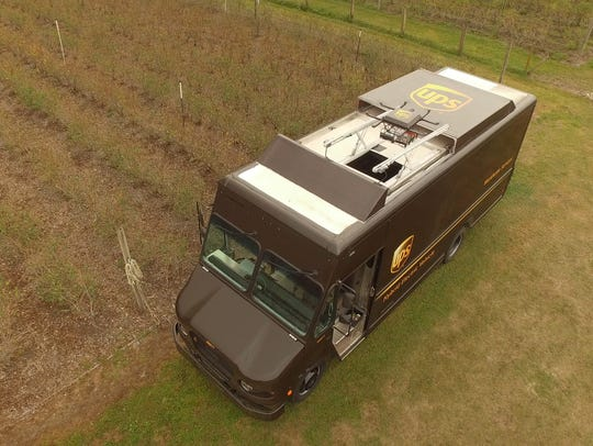 A drone-equipped UPS van, seen from above.