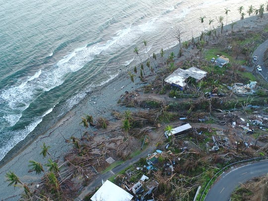 Houses that were damaged by Hurricane Maria in the