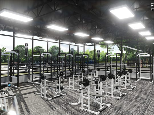 Weight room in the proposed renovation at Houston High behind the home side of the stands.