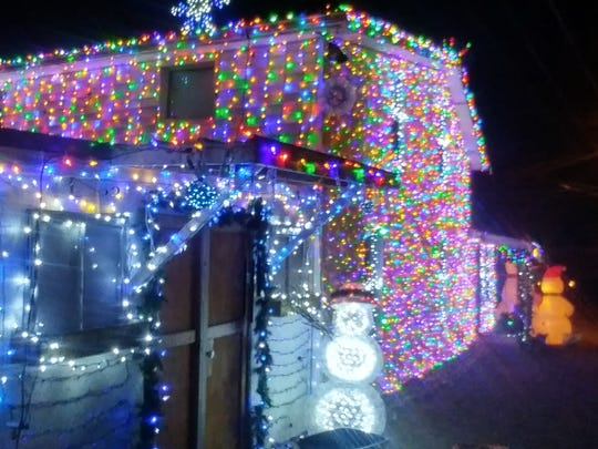 Lights cover the west side of John and Jennifer Kennedy's house at 113 Kennedy Street, Marion. The lights will move in coordination with music played on 100.1 FM each night beginning at 6 p.m.
