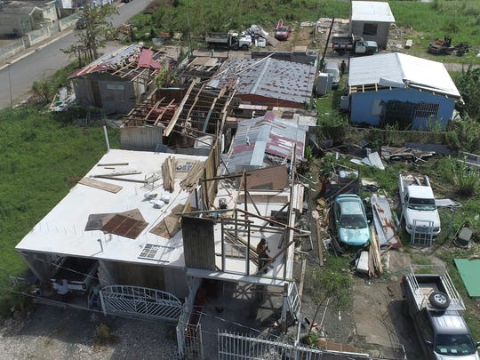 The coastal surge from Hurricane Maria reached up to 5 feet or more devastating the town of Toa Baja in Puerto Rico which can be seen in the water lines on homes Oct. 1, 2017.  In addition to flooding many homes also lost their roofs leaving many people exposed to the elements or forcing them to abandoned their homes.