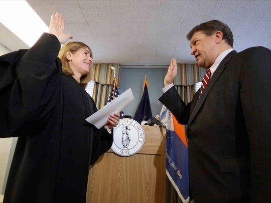 Westchester County Executive George Latimer is sworn in by Judge Gretchen Walsh at his White Plains office Jan. 1, 2018.