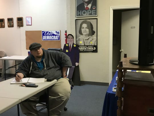 Nick Gilby, president of the Coastal Bend Young Democrats, watches President Donald Trump's State of the Union address.