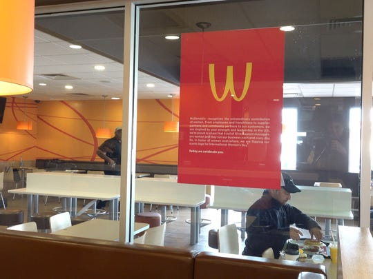 The McDonald's golden arches on a poster hanging in