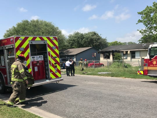 Corpus Christi firefighters put out a fire in a house