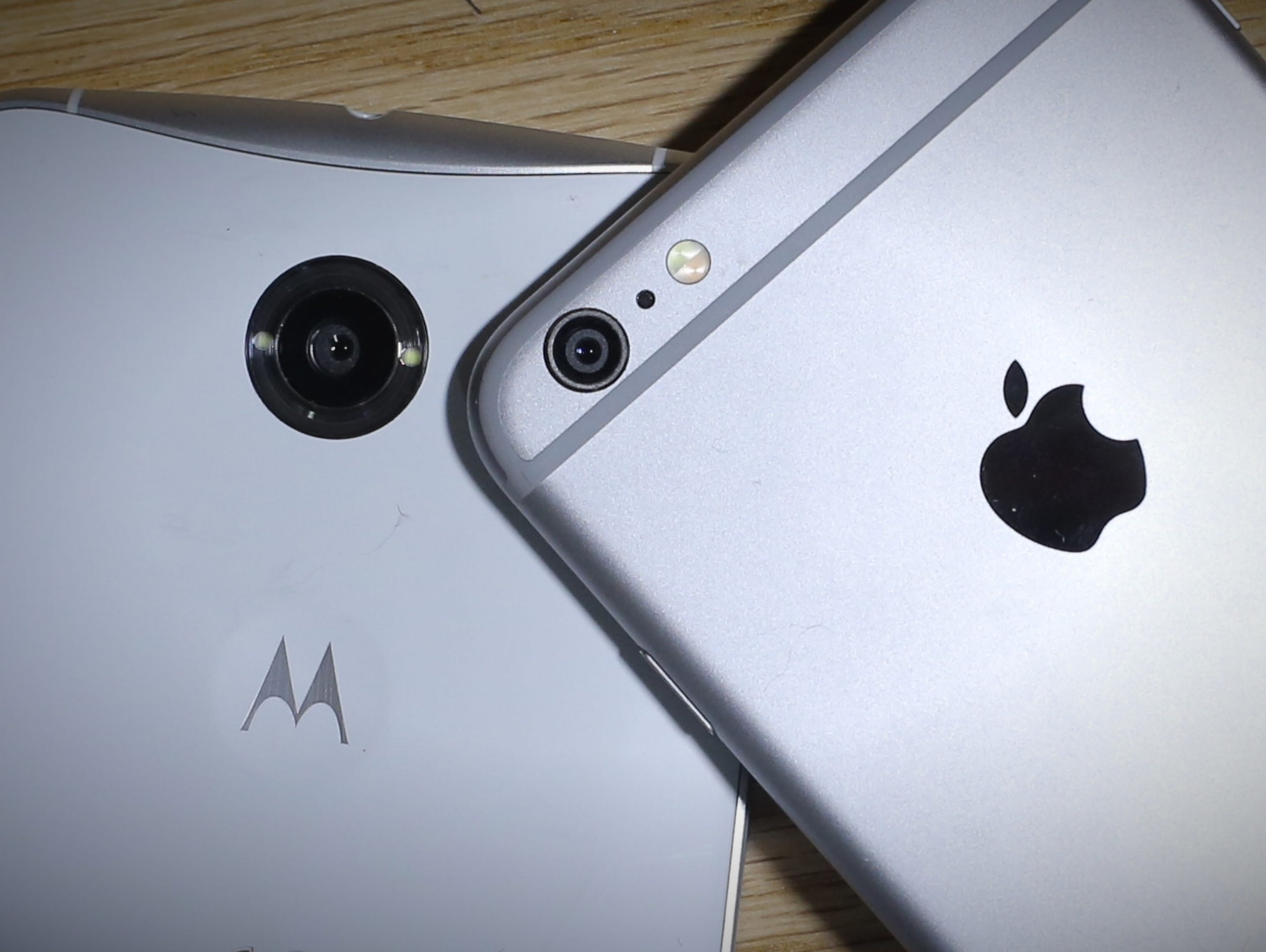The back views of the Google Nexus 6 (made by Motorola) and the Apple iPhone 6 Plus.