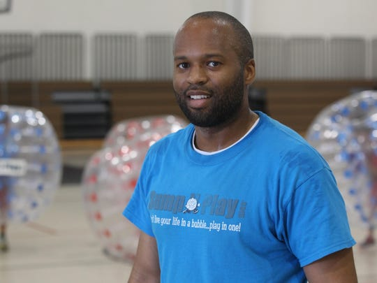 Pedro Moore, owner of Bump N Play, during a birthday party Sunday at the Police Athletic League Center in Hockessin.