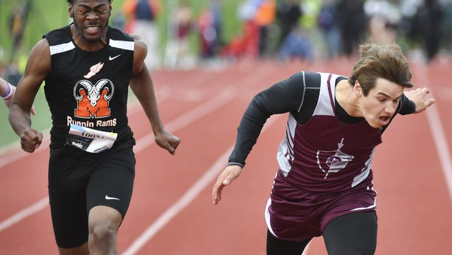 Adam Snedden of Princeville, right, crosses the finish line, winning the 100 meter dash during the Honor Roll Meet at EastSide Centre on Monday, May 20, 2019.
