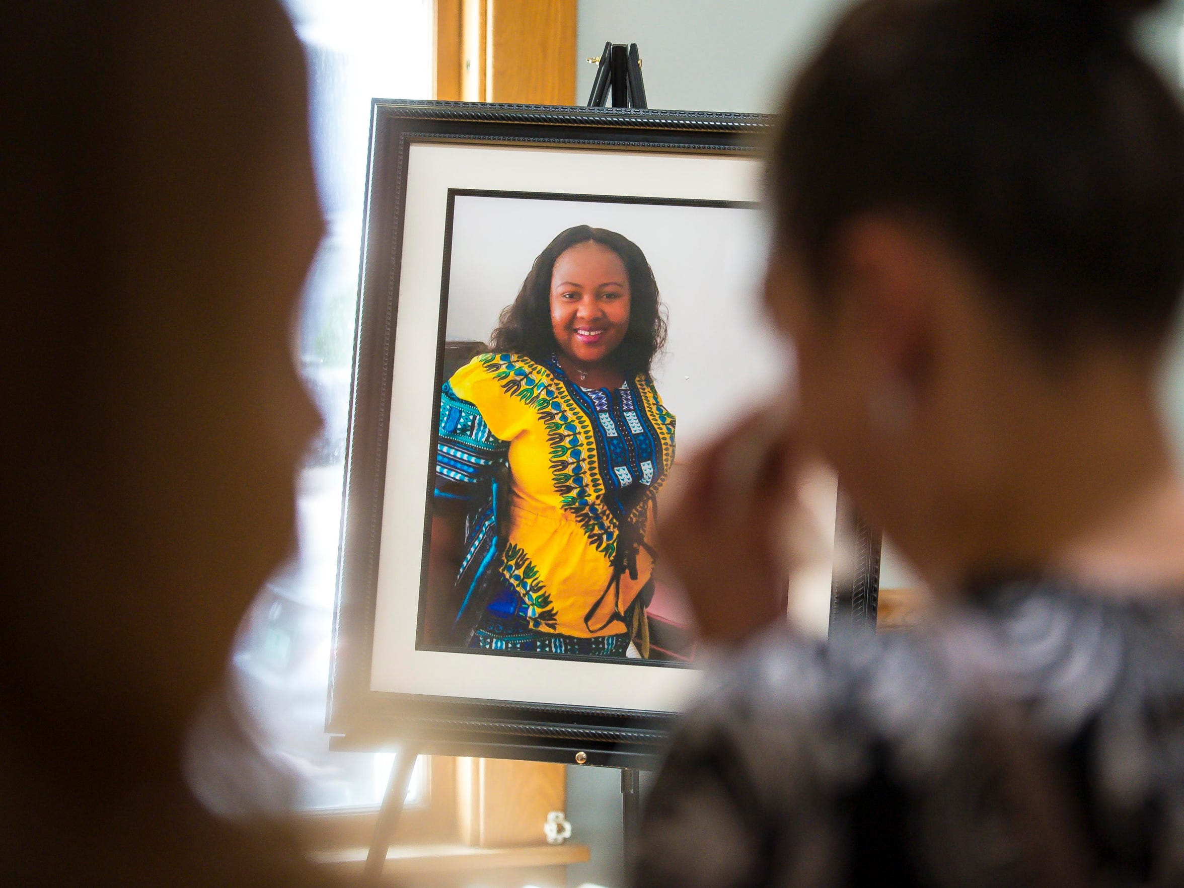 "Mourners gather at the LaVigne Funeral Home in Winooski before funeral services for Anako ""Annette"" Lumumba on Thursday, May 17, 2018."