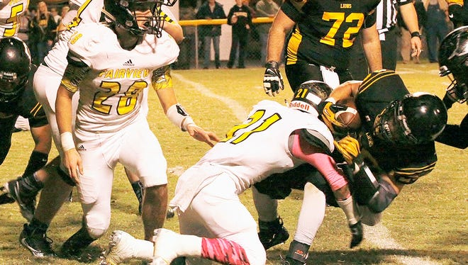 Yellow Jacket #21 safety Khristian Harris-Lusk makes great tackle to stop Camden's first down attempt.